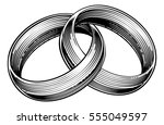 wedding rings or bands in a... | Shutterstock .eps vector #555049597