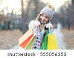 a shopping caucasian woman... | Shutterstock . vector #555056353
