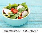 Vegetable Salad In Bowl On Blu...