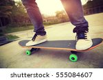 young skateboarder legs riding... | Shutterstock . vector #555084607