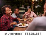 adult black family enjoy dinner ... | Shutterstock . vector #555281857
