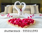two swans made from towels are... | Shutterstock . vector #555311593