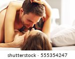 picture of young couple kissing ... | Shutterstock . vector #555354247