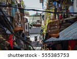 birds in the cages in streets... | Shutterstock . vector #555385753