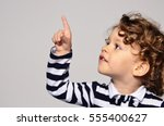 beautiful curly toddler looking ... | Shutterstock . vector #555400627