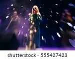 young blond woman singer in...   Shutterstock . vector #555427423