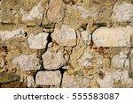 antique natural stonewall | Shutterstock . vector #555583087