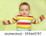 the baby sleep in a bed | Shutterstock . vector #555665797