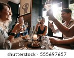 group of friends making a toast ... | Shutterstock . vector #555697657
