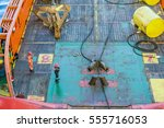 Small photo of Able-bodied seamen performing anchor handling work on board a tugboat for construction barge at oilfield