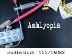 Small photo of Amblyopia word, medical term word with medical concepts in blackboard and medical equipment.