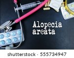 Small photo of Alopecia areata word, medical term word with medical concepts in blackboard and medical equipment.