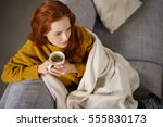 relaxed young redhead woman... | Shutterstock . vector #555830173