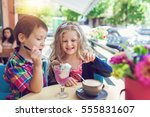 little boy with a girl eating... | Shutterstock . vector #555831607