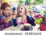 little boy with a girl eating... | Shutterstock . vector #555831643