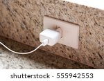 mobile phone charger plugged on ... | Shutterstock . vector #555942553