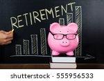 piggybank with retirement plan... | Shutterstock . vector #555956533