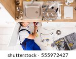high angle view of male plumber ... | Shutterstock . vector #555972427