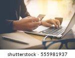 online payment man's hands... | Shutterstock . vector #555981937