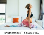 woman doing yoga exercise on... | Shutterstock . vector #556016467