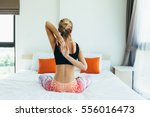 woman doing yoga exercise on... | Shutterstock . vector #556016473