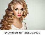 beautiful girl with long wavy... | Shutterstock . vector #556032433