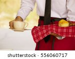 waiter is serving coffee and... | Shutterstock . vector #556060717
