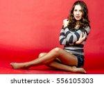 young cheerful girl in denim... | Shutterstock . vector #556105303