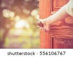 women hand open door knob or... | Shutterstock . vector #556106767