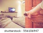 women hand open door knob or...   Shutterstock . vector #556106947