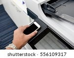 using smart phone with printer... | Shutterstock . vector #556109317