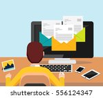 person reading email on desktop ... | Shutterstock .eps vector #556124347