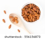 almonds top view on white table | Shutterstock . vector #556156873