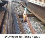 Small photo of The mild steel cutting process using oxy cutter. Flame produces from Acetylene burn with oxygen.