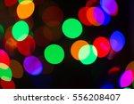 colorful bokeh on black... | Shutterstock . vector #556208407