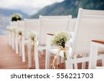 wedding chairs with flowers...   Shutterstock . vector #556221703