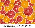 slices of fresh orange and... | Shutterstock . vector #556235233