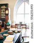 vintage books and a lamp on the ...   Shutterstock . vector #556251493