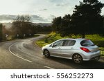 asphalt road with cars passing... | Shutterstock . vector #556252273