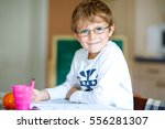 portrait of cute happy school... | Shutterstock . vector #556281307