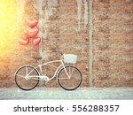 vintage bicycle parked beside... | Shutterstock . vector #556288357