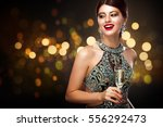 woman in evening dress with... | Shutterstock . vector #556292473