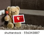 teddy bear with red hearts... | Shutterstock . vector #556343887