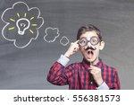 smart little kid with fake... | Shutterstock . vector #556381573