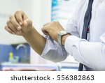 men wearing white shirt sleeves ... | Shutterstock . vector #556382863