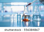 flask and vial with orange... | Shutterstock . vector #556384867