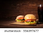two bbq hamburgers with cola on ...   Shutterstock . vector #556397677