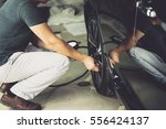 check tire pressure with tire... | Shutterstock . vector #556424137