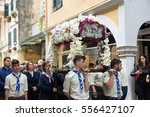"""Small photo of CORFU, GREECE - APRIL 29, 2016: The epitaph processions of Good Friday in Corfu. In Corfu every church is organizing a litany, carrying its """"Epitaphios"""" and with the accompaniment of philharmonics."""