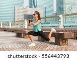 sporty female athlete doing... | Shutterstock . vector #556443793